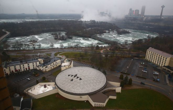 The long-vacant Native American Center for the Living Arts in Niagara Falls, known as the Turtle, sits a stone's throw from the upper rapids above Niagara Falls. The unique building features skylights in the shape of an eagle. Photo by News staff photographer John Hickey.
