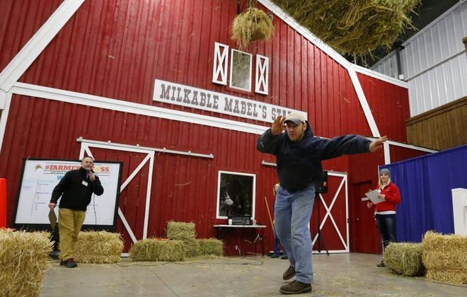 The hay bale toss is not the only competition at the Western New York Farm Show. (Mark Mulville/Buffalo News)