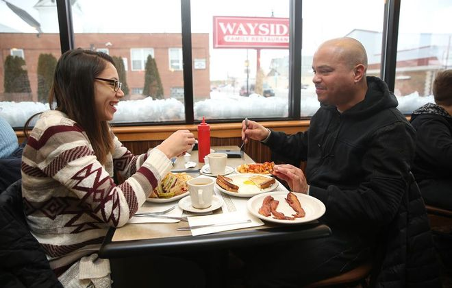 Shakira Perez, left and her father Jose Perez, of South Buffalo, have lunch at Wayside. (Sharon Cantillon/Buffalo News)