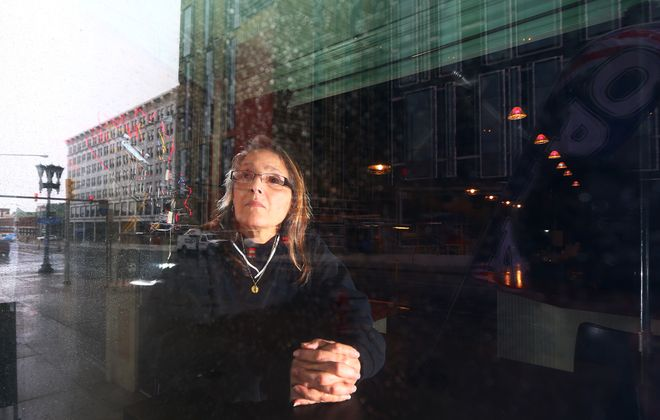 Roslyn M. Righetti inside her pub at 946 Main St. that she's now trying to sell after 12 years of ownership. (John Hickey/Buffalo News)