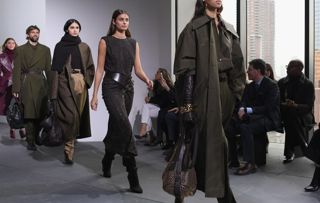 Models walk the runway during the Michael Kors Collection for  Fall 2017 show on Feb. 15 during New York Fashion Week. Long, voluminous coats and pleated trousers were among the highlights. (Getty Images)