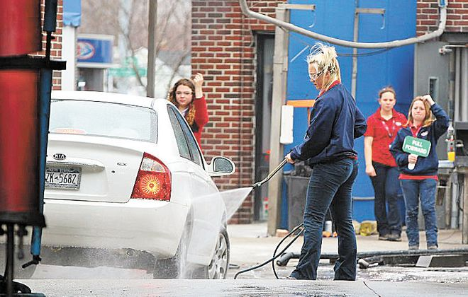 A car gets a sprayed before entering the wash at a Delta Sonic on Niagara Falls Boulevard in Amherst.  (Mark Mulville/News file photo)