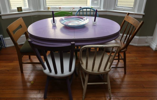 "Elmwood Village resident Therese Deutschlander painted the dining chairs in her apartment purple, turquoise and green, while leaving the other three in their original finish. Her place was featured as The Buffalo News ""Home of the Month"" in April 2016. (Photo by Sharon Cantillon/Buffalo News)"