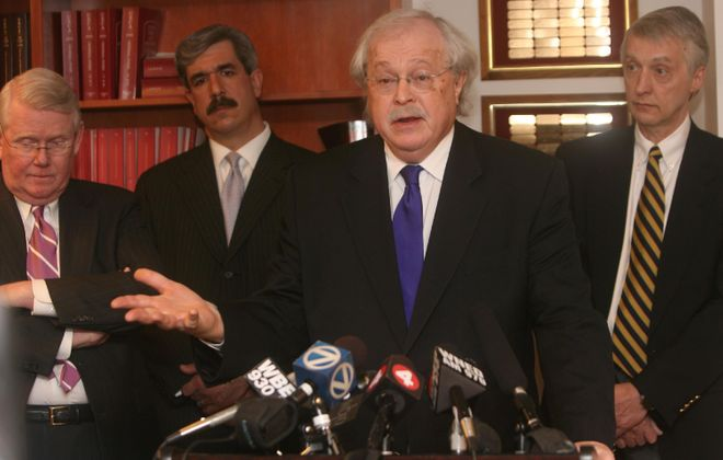 Dr. Michael M. Baden, at  a press conference about the Lynn DeJac case, in 2008, with, from left, District Attorney Frank J. Clark, top homicide prosecutor and future DA Frank A. Sedita III, and Dr. James J. Woytash. /Buffalo News photo by Charles Lewis.