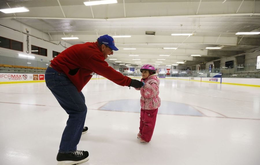 Constance Otis ice skates with her grandfather Dave Borchard at the Northtown Center at Amherst in this 2017 photo. The Town of Amherst is proposing raising the general skate fees at the facility. (Mark Mulville/Buffalo News file photo)