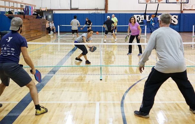 Melissa Palma (left) and Linda King play a rousing game of pickleball at First Baptist Church in West Seneca. (Dave Jarosz)