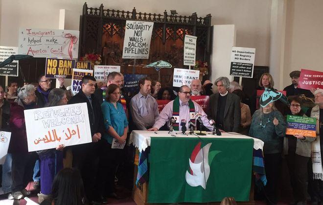 Rev. Justo Gonzalez II, pastor of Pilgrim-St. Luke's, announced his church would offer sanctuary to immigrants seeking shelter. (John Hickey/Buffalo News)