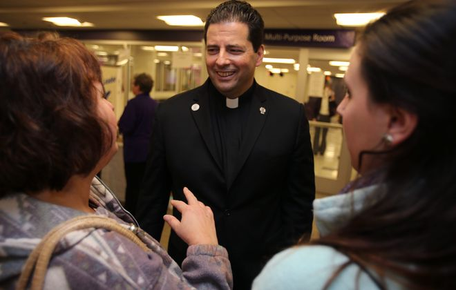 """The Rev. James J. Maher, president of Niagara University, said the university is """"eager and grateful to have this opportunity to enhance the family-focused work of Help Me Grow."""""""