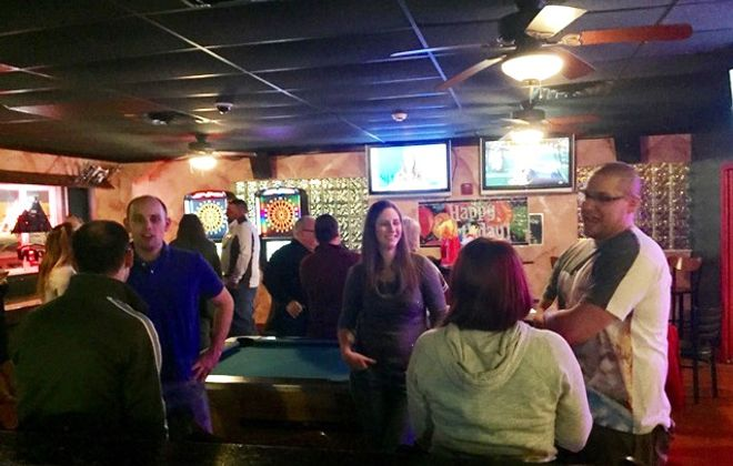Patrons hang out in Shenannigans in Amherst. (via Shenannigans).