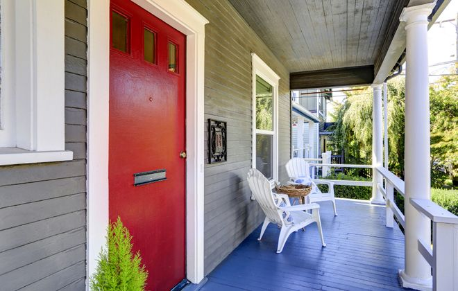 A bright red door sends a cheerful hello to visitors.