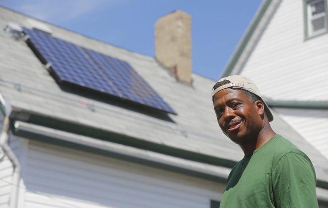 Schuyler Banks had solar panels installed on his Lemon Street home as part of National Grid's $3.7 million demonstration program. (Mark Mulville/News file photo)