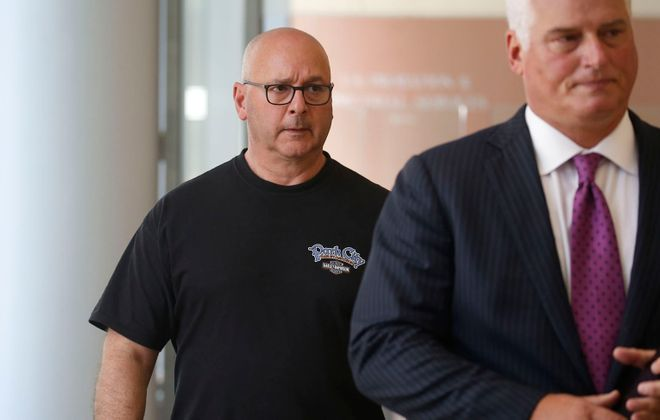 Louis P. Ciminelli, left, leaves court with his attorney Daniel C. Oliverio, after facing charges of  rigging and bribery in federal court in Buffalo on Sept. 22. (Robert Kirkham/News file photo)