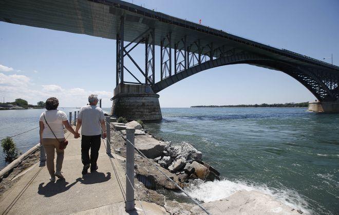 Michelle and Mark Griep, of Minneapolis, Minn., walk along Bird Island Pier, approaching the Peace Bridge, 2017. (Sharon Cantillon/Buffalo News file photo)