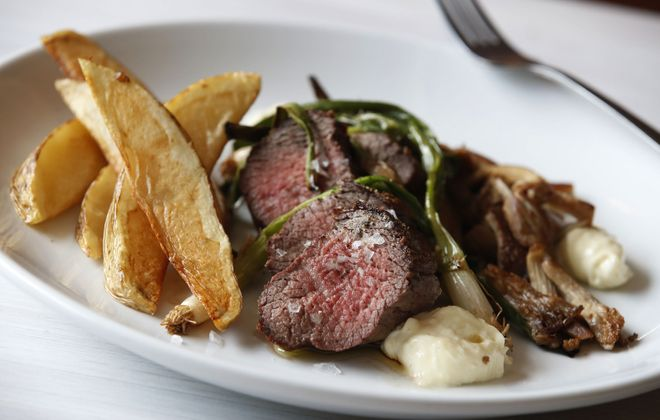 The steak frites at Lait Cru Brasserie aren't the only draw: The restaurant now offers liquor and custom cocktails. (Sharon Cantillon/News file photo)