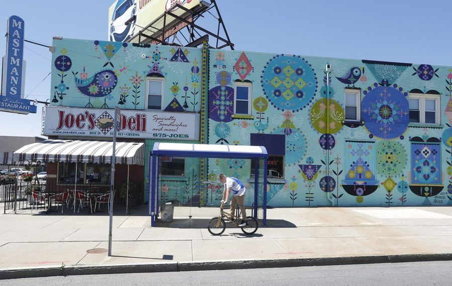 """Magic Buffalo,"" a new mural by the Los Angeles-based artist Bunnie Reiss, is on three sides of 1322 Hertel Ave. (John Hickey/Buffalo News)"