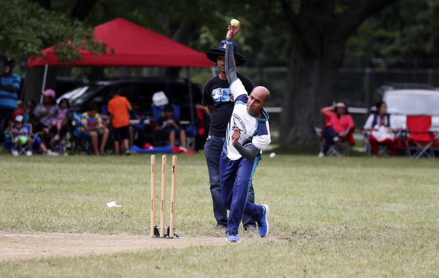 Cricket Bowler Murthy Ganapathy throws a ball in a match at a baseball field that has been converted into a cricket field in Ellicott Creek Park in the Town of Tonawanda on Sunday July 16, 2017. (John Hickey/Buffalo News)