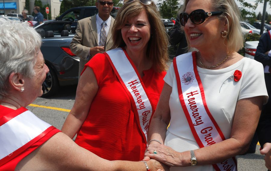 NYS Assembly Member Monica Wallace, center, looks on as Lottie Pulaski, left, greets the Secretary of State of Poland Anna Maria Anders at the Pulaski Day Parade in Cheektowaga on Sunday, July 16, 2017. (John Hickey/Buffalo News)