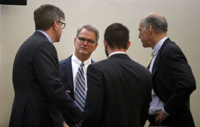 Ross Cellino speaks with his attorneys before a hearing with Judge Deborah Chimes in Buffalo on July 27, 2017. (Mark Mulville/News file photo)
