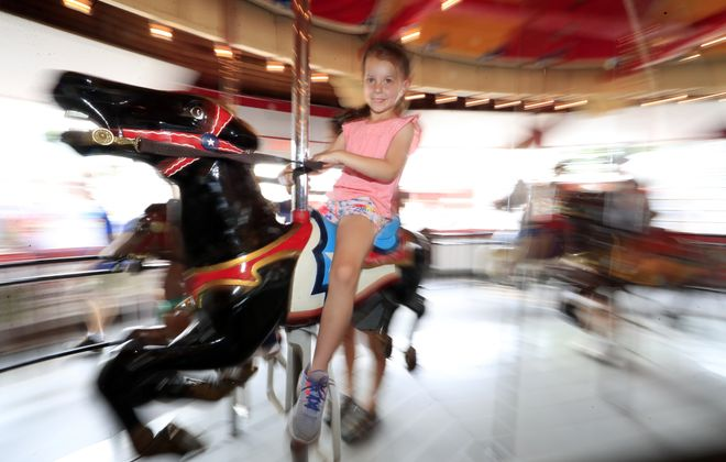 The fully restored 1928 Herschell-Spillman carousel is the centerpiece of the Olcott Beach Carousel Park.  (Harry Scull Jr./Buffalo News file photo)