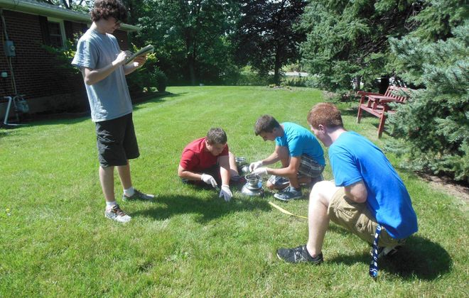 Soil samples are collected by Evan James, Jon Rusch, Alex Rusch and Robert Bennett. (Photo courtesy of CSCR Director Jackie James-Creedon)