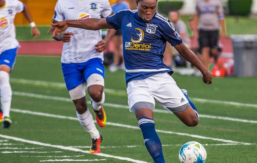 FC Buffalo striker Akean Shackleford hits the ball with his left against Erie. The Jamaican striker will return to the club for summer 2018. (Don Nieman/Special to The News)