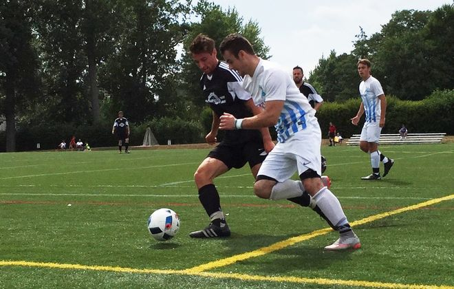 Both of the BDSL first-division finalists in 2016 are now in the championship division playoffs in 2017. Pictured are Panthers, in black, and Willies, in white. (Ben Tsujimoto/Buffalo News file photo)