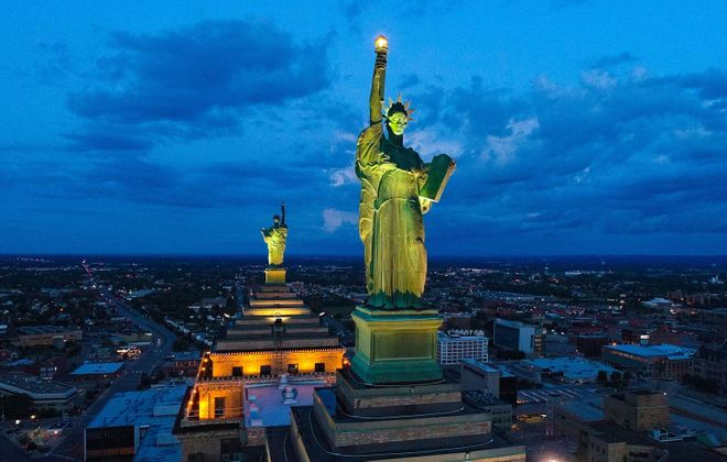 Week 2: Statues of Lady Liberty glow atop the Liberty Building. (Derek Gee/Buffalo News)