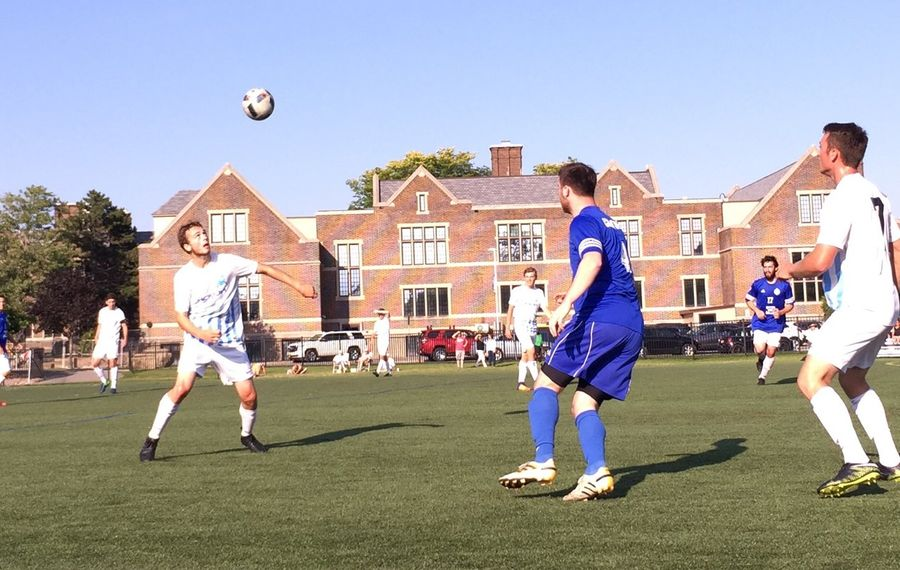 Williamsville Willies, in white, cruised to an easy win over Niagara FC. Pictured is Willies' midfielder Thomas Jackson heading the ball. (Ben Tsujimoto/Buffalo News)