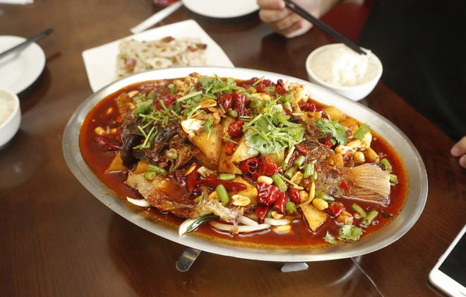 The hot & Spicy Grilled Fish is one of the many dishes to be enjoyed family style at China Star. (John Hickey/Buffalo News)