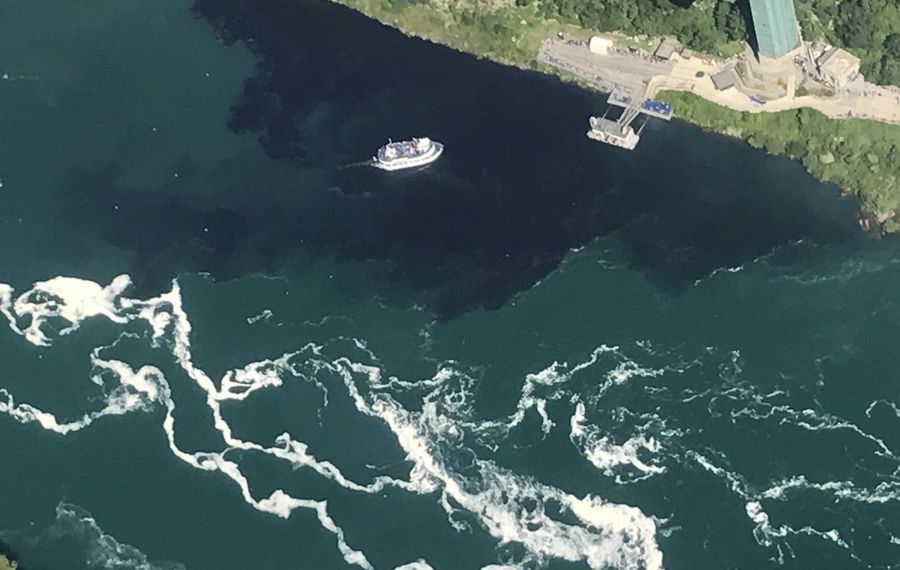 The black discharge from the Niagara Falls Wastewater Treatment Plant engulfed the Maid of the Mist docks on July 29.(Courtesy of Rainbow Air Inc.)