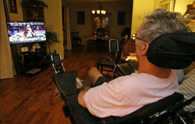 Dan Piccioli watches his son Bryan, pictured on TV, in the World Series of Poker Main Event. (Robert Kirkham/The Buffalo News)