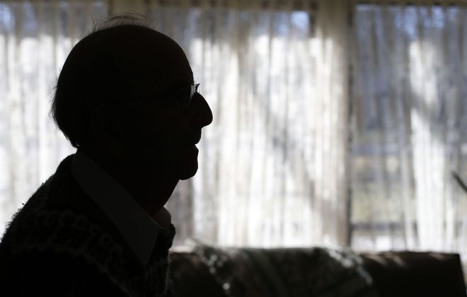 Herman Stone is one of 28 people in Western New York who lived through the Holocaust. (Mark Mulville/Buffalo News)