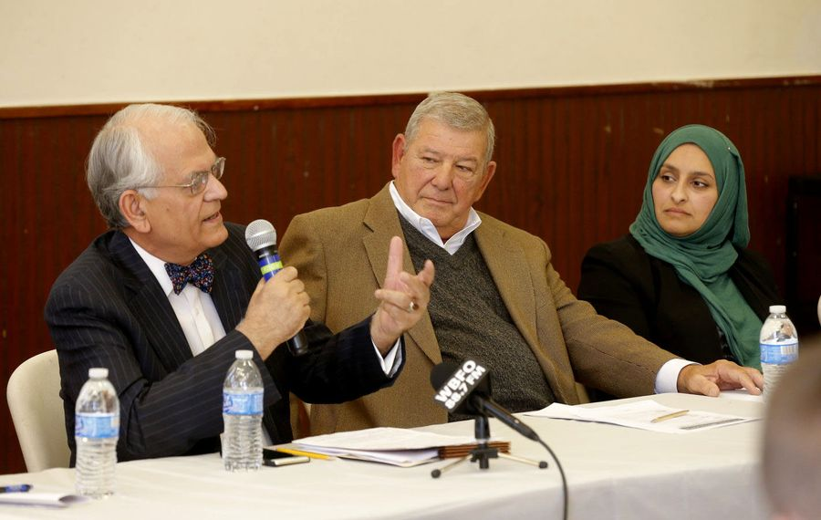 A panel, from left, Dr. Khalid J. Qazi, Lee Coppola  and Gamileh Jamil discusses journalism and Islam. (Robert Kirkham/Buffalo News)