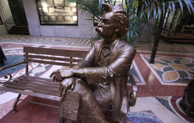 A new statue of Mark Twain sitting on a bench is in the lobby of the Ellicott Square Building in Buffalo. The statue was the dream of a former Buffalo News reporter, the late Irene Liguori. Developer Carl Paladino had the statue erected in the building. (John Hickey/Buffalo News)
