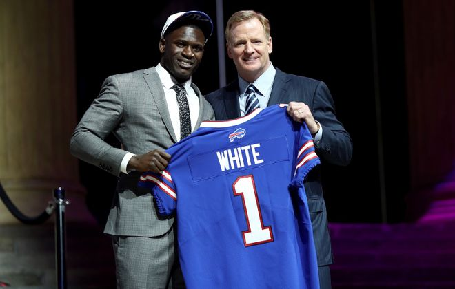 Tre'Davious White poses with NFL commissioner Roger Goodell after being drafted by the Bills. (Getty Images)