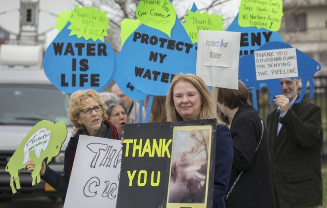 A small group gathered outside the Rev. Smith Family Life Center to thank the governor for denying approval for the proposed Northern Access natural gas pipeline. (Derek Gee/Buffalo News)
