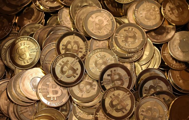 Described by advocates as a digital or virtual currency, bitcoin is a medium of exchange that, unlike the dollar, is completely decentralized. (Getty Images)