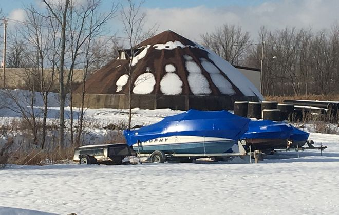 Submitted photo of shrink-wrapped boats at highway garage