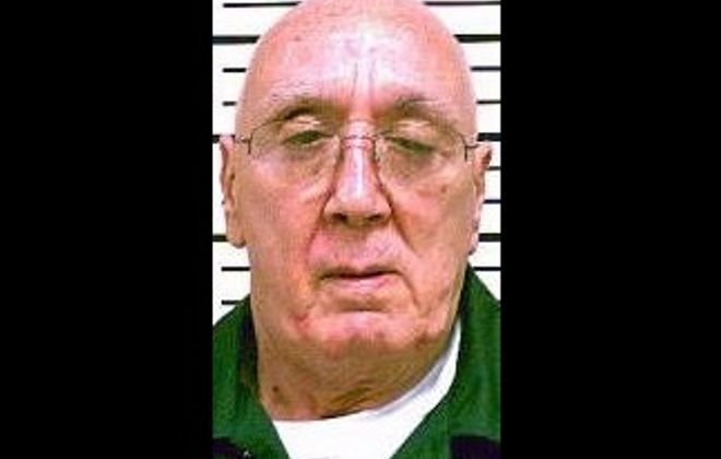 Cop killer Albert Victory is suing New York State, claiming political pressure prompted officials to revoke his parole and make him spend extra time in prison.