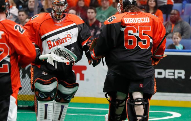 Starting goaltender Anthony Cosmo is pulled for Davide DiRuscio during first quarter action against the Rush. (Harry Scull Jr./Buffalo News)