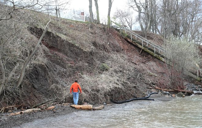 Al Weir looks at the significant erosion to his lakefront property in Burt.  (Sharon Cantillon/Buffalo News)