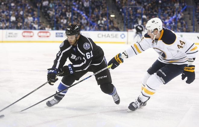 Tampa Bay Lightning center Gabriel Dumont (61) works to get around Buffalo Sabres left wing Nicolas Deslauriers (44) during first period action at the Amalie Arena in Tampa Sunday afternoon.(Dirk Shadd/Tampa Bay Times