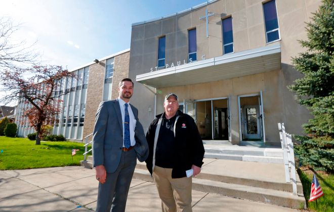 """Larry Bicz, right, with his attorney Todd J. Potter, Jr.,  announced plans to begin the project that will turn the old St. Paul's school in Kenmore into """"faith-based"""" apartments. (Robert Kirkham/Buffalo News)"""