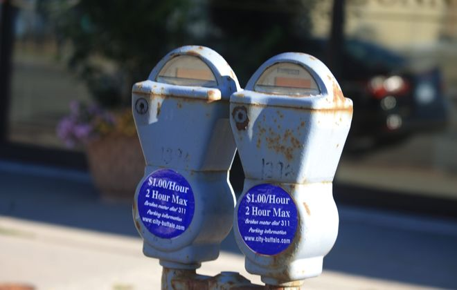 Traditional parking meters on Hertel Avenue. (John Hickey/Buffalo News)