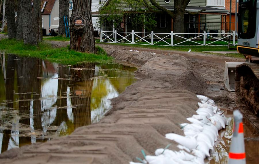 Crews use sand to keep homes from being flooded at the corner of Jackson and Lake Streets in Olcott Thursday, May 4, 2017.             (Mark Mulville/Buffalo News)