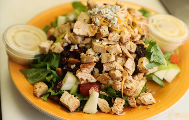 The apple chicken salad with house apple vinaigrette is one of the many dishes at Steveo's Tacos & Subs.   (Sharon Cantillon/Buffalo News)