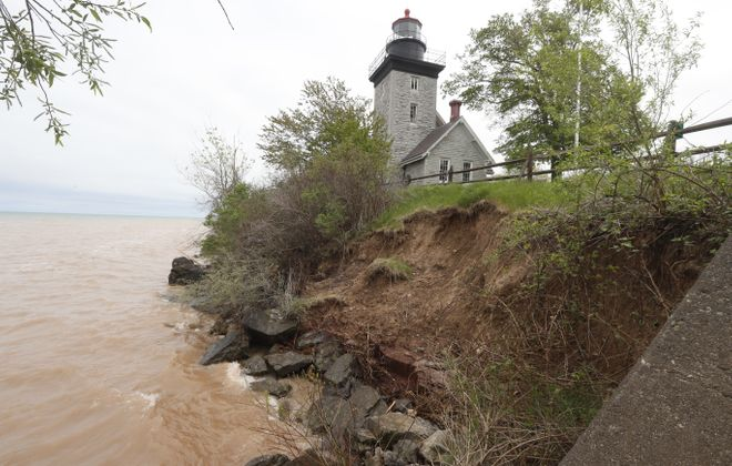 Erosion along the  banks of Lake Ontario threatens the Thirty Mile Point Lighthouse at Golden Hill State Park, Friday May 19, 2017, in Somerset, N.Y.    (John Hickey/Buffalo News)