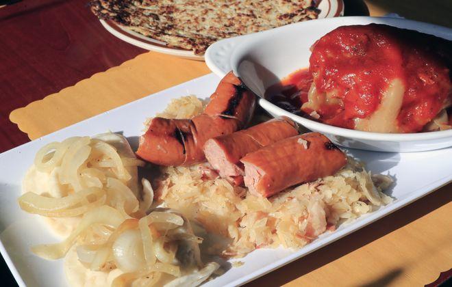 The Polish Platter for Two includes two golumbki (stuffed cabbage) smoked Polish sausage, sauerkraut, four pierogi and two potato pancakes at Matka & Papa's Restaurant & Bar. (Harry Scull Jr./Buffalo News)