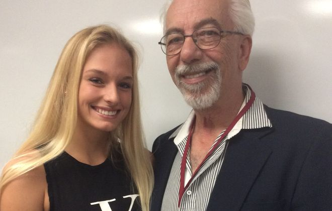Tonawanda High School senior Cassandra Butzer was awarded the New York State Senate Liberty Medal on Wednesday, May 31, 2017 at her school for helping save the life of her neighbor, Dennis Alviti, when his house caught fire.  (Nancy Fischer/Buffalo News)