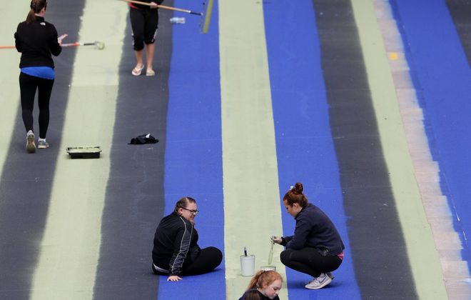 """Lewiston-Porter High School art students reinstall the painted parking lot artwork titled """"Niagara 1979"""" by Gene Davis in 2017. (Mark Mulville/News file photo)"""